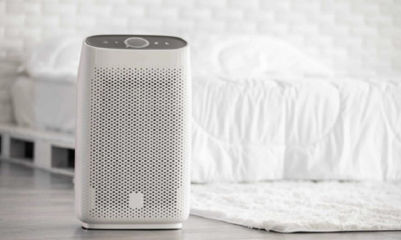 An air purifier in a bedroom.