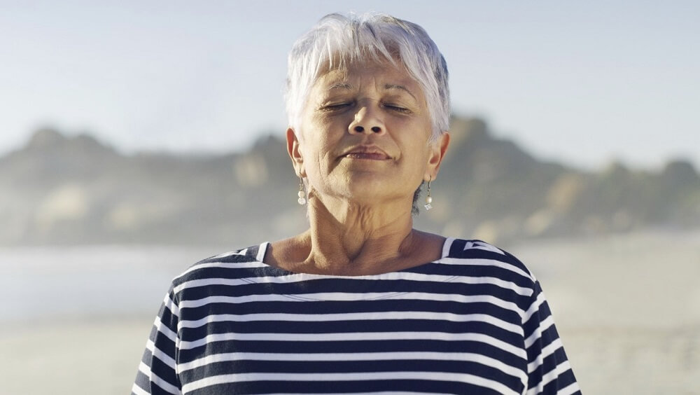 An old lady inhaling fresh air