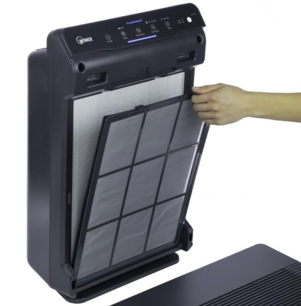 A person removing a Winix filter