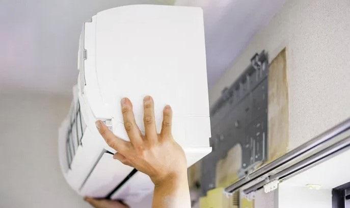 A person installing an air con